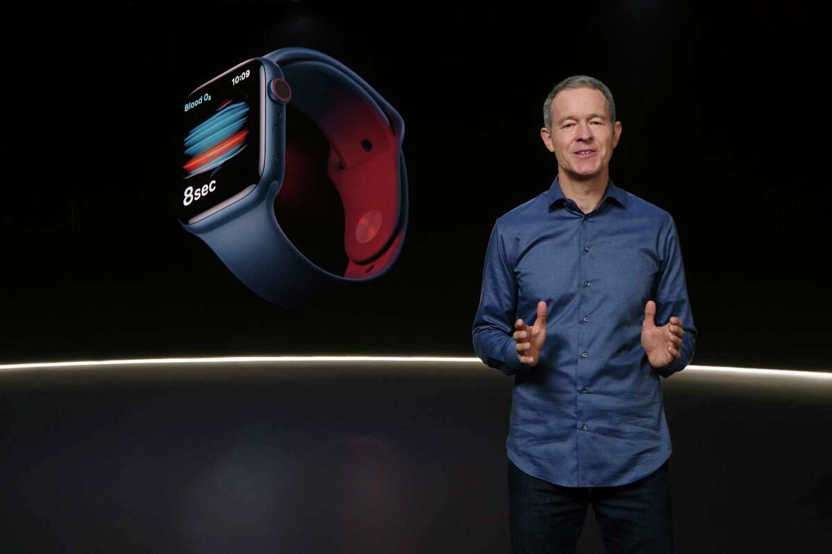 In this still image provided by Apple from the keynote video of a special event at Apple Park in Cupertino, Calif., Apple's Chief Operating Officer Jeff Williams unveils Apple Watch Series 6 on Tuesday, Sept. 15, 2020. Apple is introducing the cheaper version of its smart watch in its latest attempt to broaden the appeal of its trend-setting products while more consumers are forced to scrimp during ongoing fallout from the pandemic. (Apple via AP)