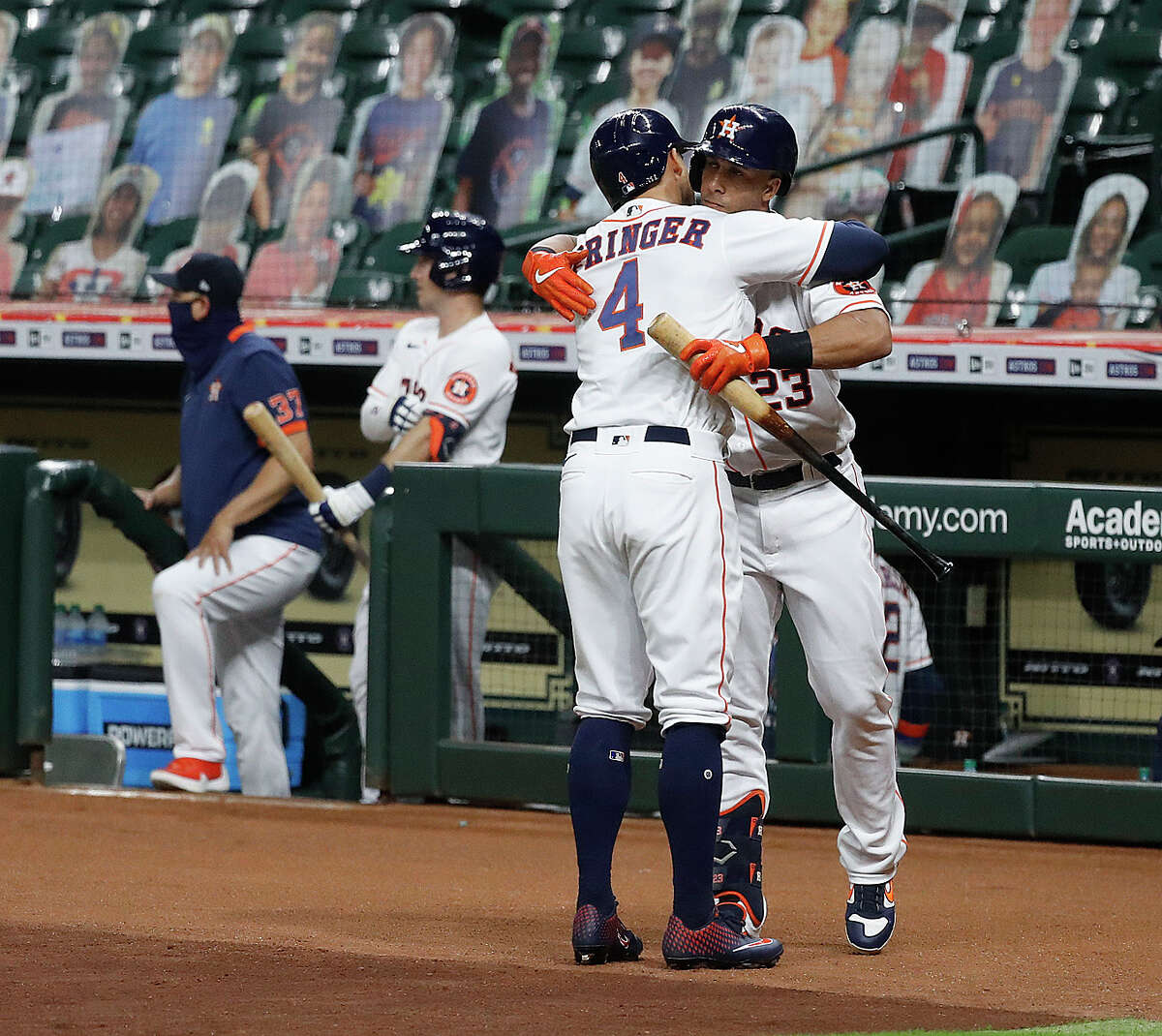 Houston Astros George Springer (4) hugs Michael Brantley (23) after his home run during the first inning of an MLB baseball game at Minute Maid Park, Tuesday, September 15, 2020, in Houston.