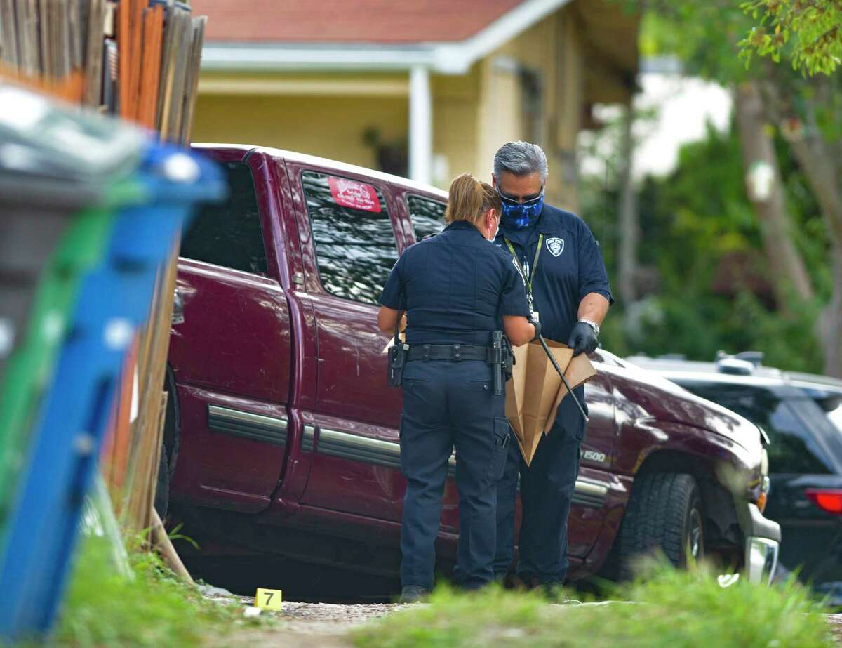 Investigators collect a telescopic baton at the scene where police, while executing a warrant, shot and killed a man in the 100 block of Willee Drive on Tuesday, Sept. 15, 2020. A family friend identified the man as Darrell Zemault Sr.