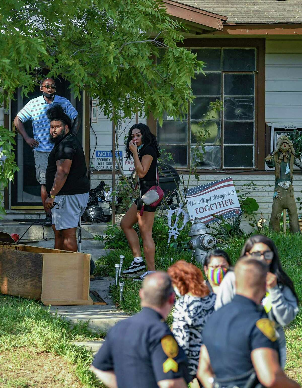 Family and friends of a man shot and killed by police who were executing a warrant gather at the home in the 100 block of Willee Drive on Tuesday, Sept. 15, 2020. A family friend identified the man as Darrell Zemault Sr.