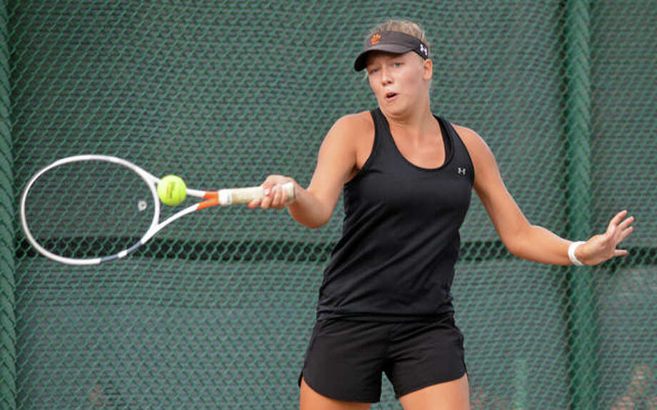 Edwardsville's Hannah Cobert makes a forehand return during her No. 2 singles match against Alyssa Riley at Belleville West. Photo: Scott Marion/The Intelligencer