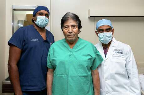 On Thursday, September 10, 2020 Francisco Medellin poses with his doctors, Dr. Soma Jyothula and Dr. Manish Patel who performed the double lung transplant at Memorial Hermann Hospital after Francisco came down with coronavirus in Houston Texas.