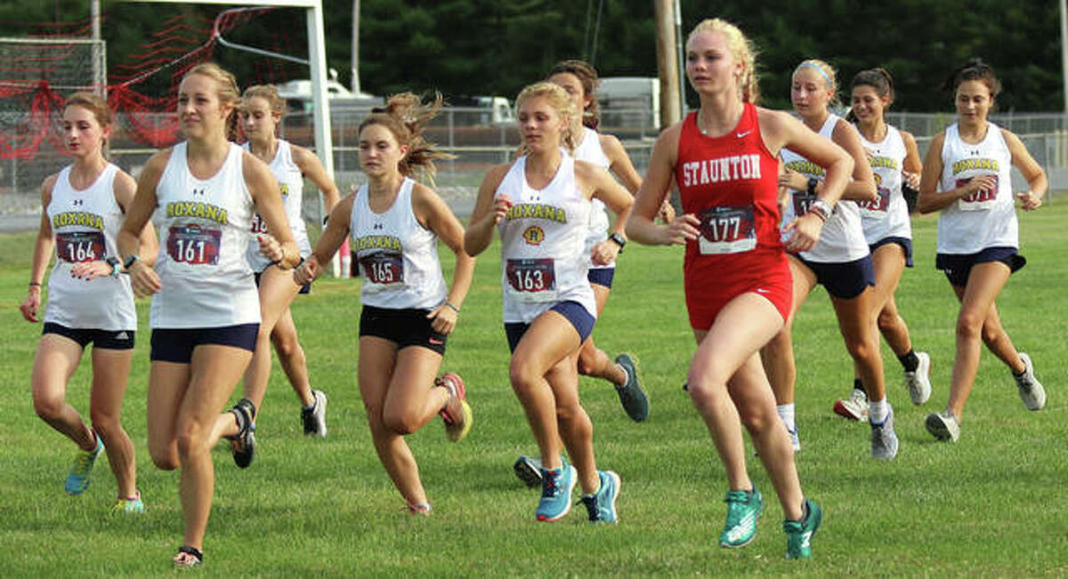 Staunton's Dana Jarden runs with a herd of Roxana Shells at the start of the girls race in the Staunton Invite on Tuesday at the Staunton Soccer Complex.