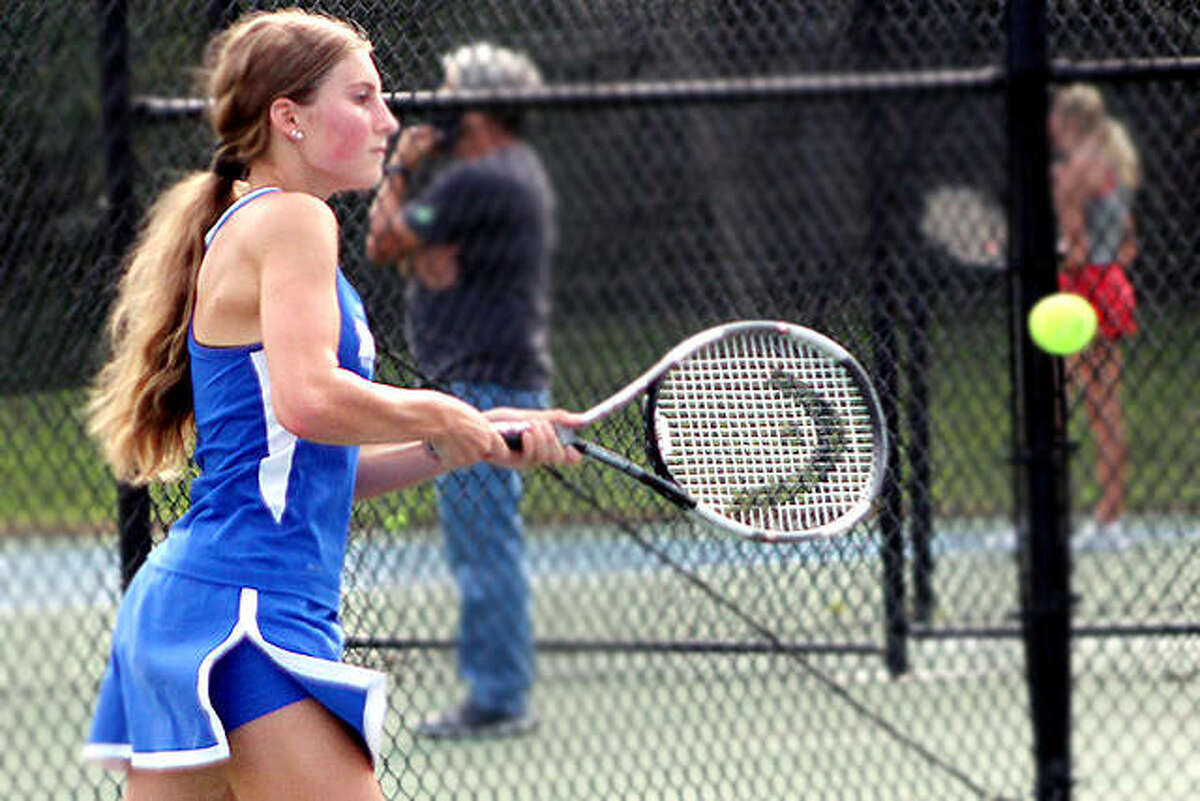 Monica Wendel of Marquette Catholic makes a return during her No. 1 singles victory over Alton's High's Lydia Criveau Monday at the Simpson Tennis Complex at Gordon Moore Park. Wendel won 6-0. 6-2.