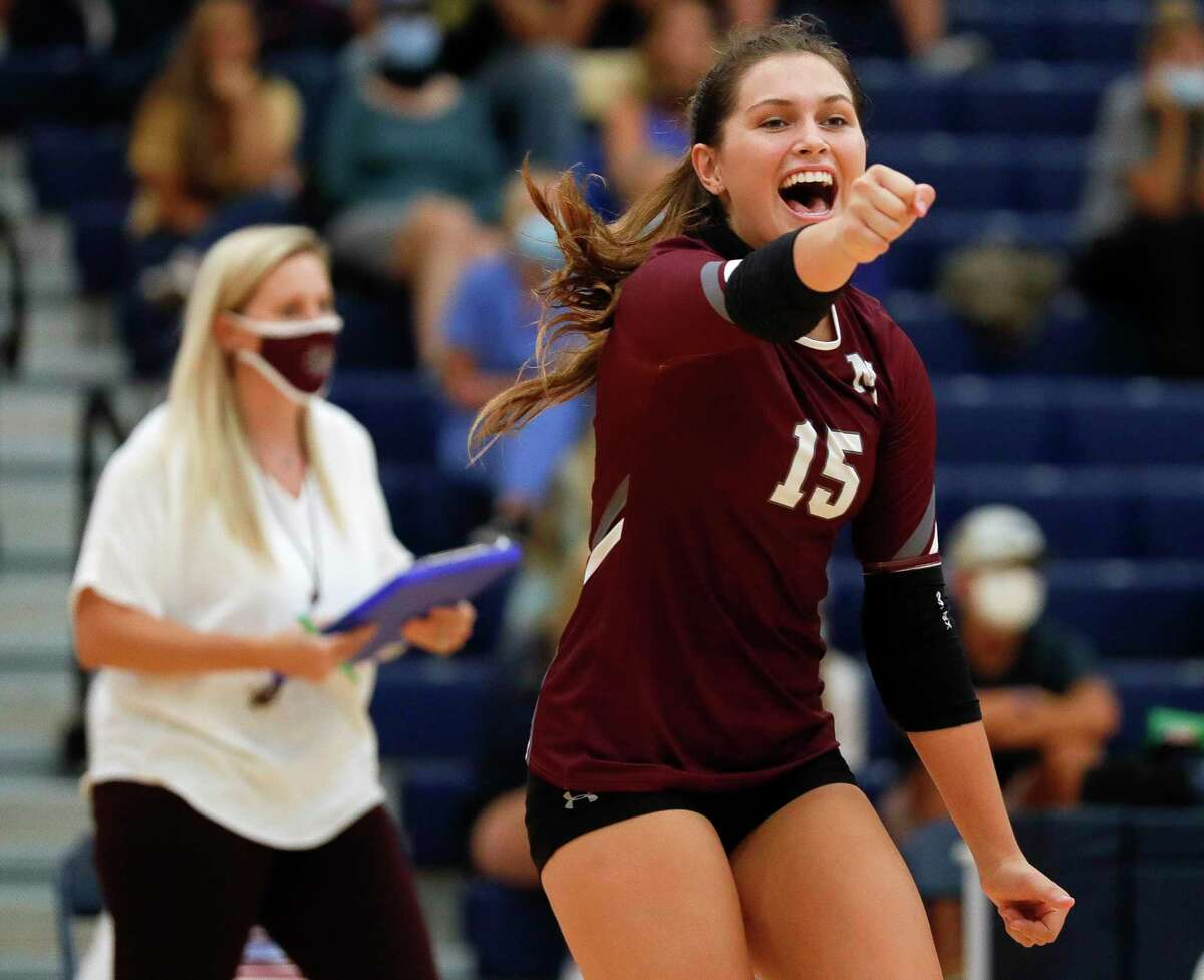Magnolia libero Kaylyn Fojt (15) reacts after a point during the first set of a non-district high school volleyball match at Lake Creek High School, Tuesday, Sept. 15, 2020, in Montgomery.
