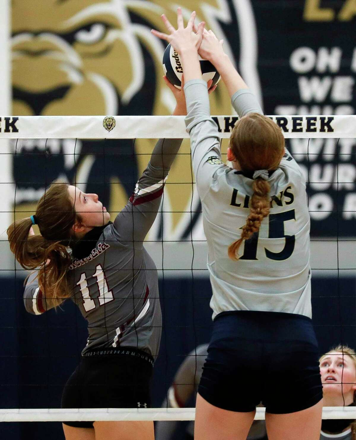 Lake Creek middle blocker Madison Blane (15) blocks a shot by Magnolia setter Faith Lynch (11) during the first set of a non-district high school volleyball match at Lake Creek High School, Tuesday, Sept. 15, 2020, in Montgomery.