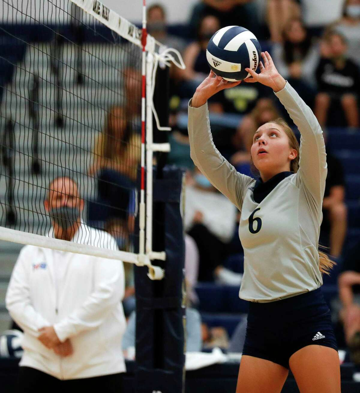 Lake Creek setter Regan Wells (6) pushes the ball during the first set of a non-district high school volleyball match at Lake Creek High School, Tuesday, Sept. 15, 2020, in Montgomery.