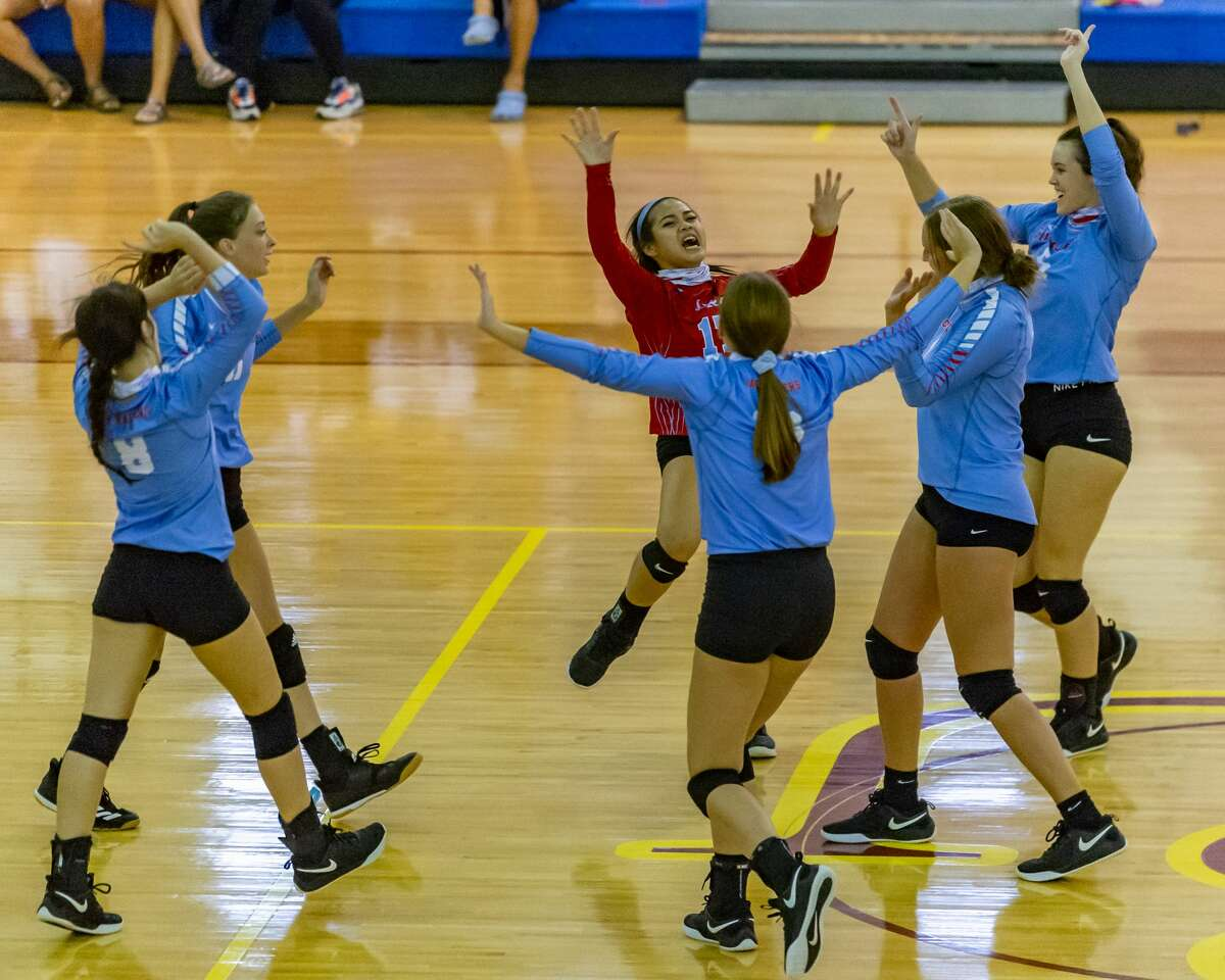 The Lady Raiders of Lumberton celebrate a point during the match as they downed the Lady Bruins of West Brook and the Lady Wolves of Beaumont United at the Tri-Match held at Beaumont United on Tuesday night. Photo made on September 15, 2020. Fran Ruchalski/The Enterprise