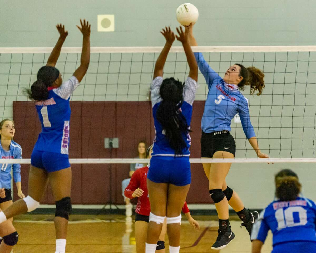 Lumberton's Lana Leggett (5) finesses the ball over the net as the Lady Raiders of Lumberton downed the Lady Bruins of West Brook and the Lady Wolves of Beaumont United at the Tri-Match held at Beaumont United on Tuesday night. Photo made on September 15, 2020. Fran Ruchalski/The Enterprise