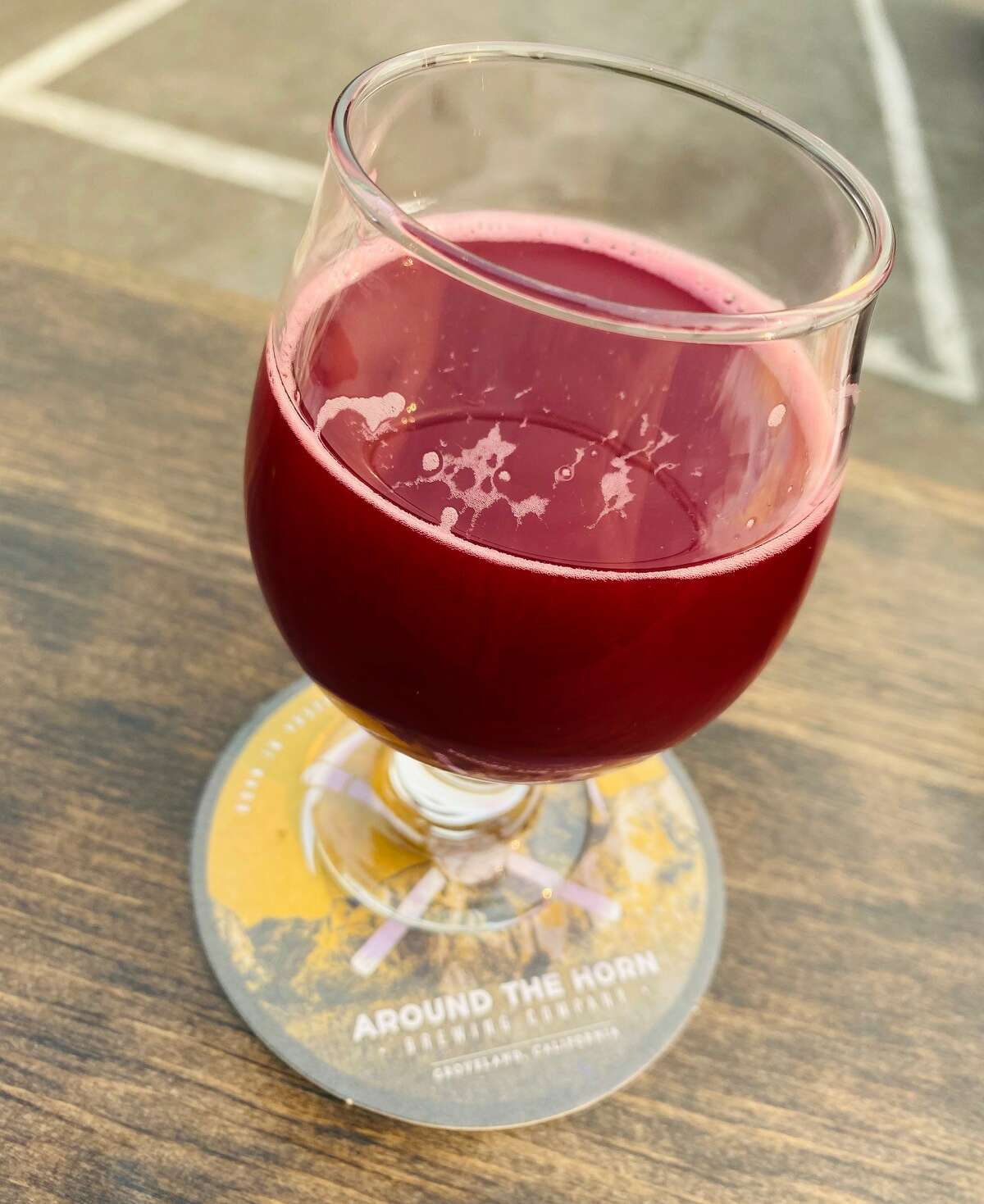 Tip Top Lollipop beer brewed with raspberry, black currant and vanilla.