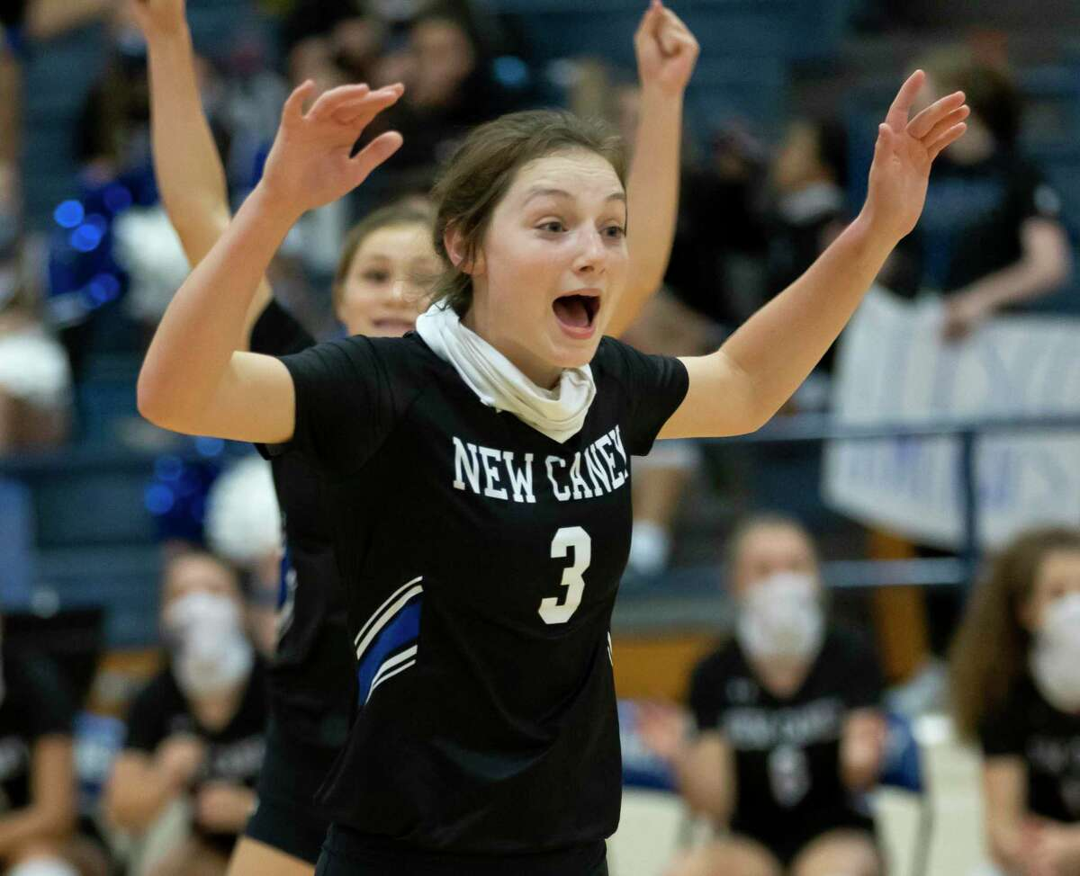 New Caney middle hitter Erin Plunkett (3) cheers after her team scores during a non-district volleyball match against Willis at New Caney High School, Tuesday, Sept. 15, 2020.