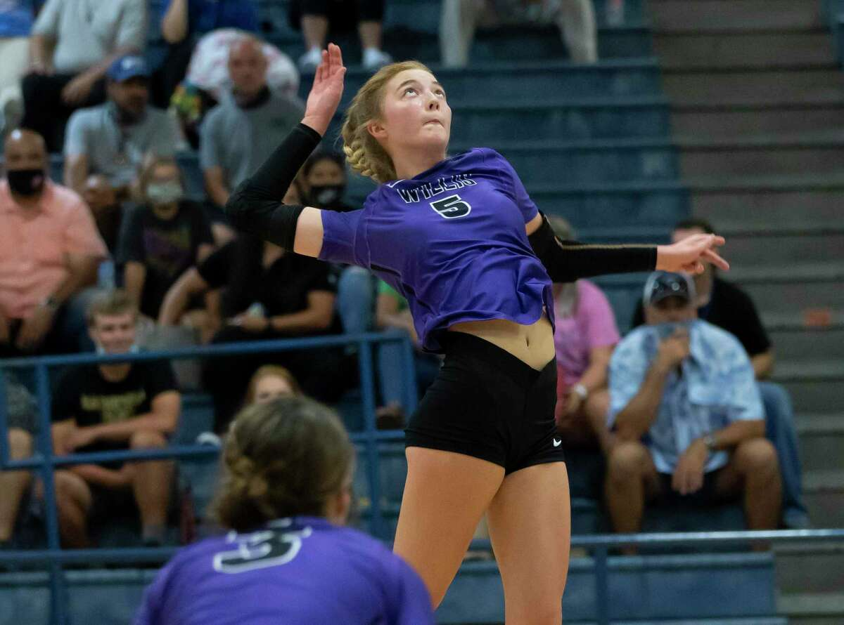 Willis junior Taylor Thomas (5) returns a serve during a non-district volleyball match at New Caney High School, Tuesday, Sept. 15, 2020.
