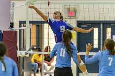 West Brook's Annalise Burbank (9) snaps the ball across the net in the early going as the Lady Raiders of Lumberton downed the Lady Bruins of West Brook and the Lady Wolves of Beaumont United at the Tri-Match held at Beaumont United on Tuesday night. Photo made on September 15, 2020. Fran Ruchalski/The Enterprise