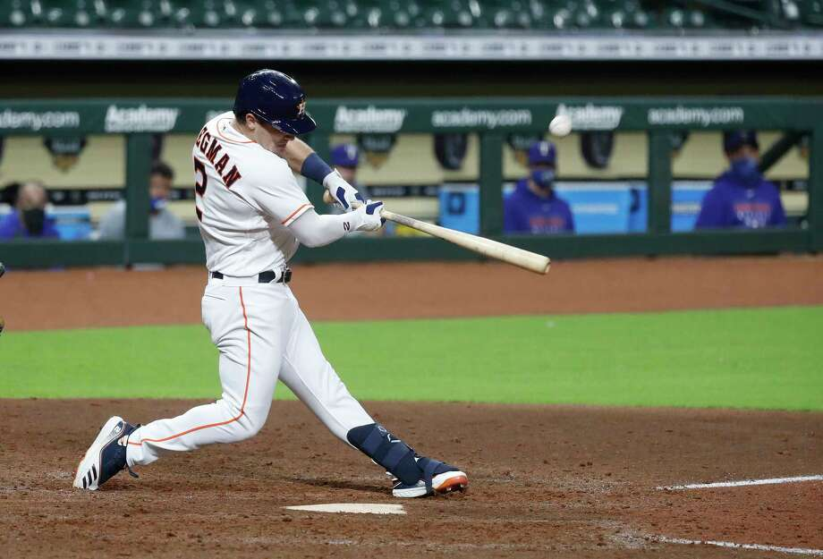 Houston Astros third baseman Alex Bregman (2) hits an RBI single scoring George Springer and Jose Altuve during the seventh inning of an MLB baseball game at Minute Maid Park, Tuesday, September 15, 2020, in Houston. Photo: Karen Warren, Staff Photographer / © 2020 Houston Chronicle