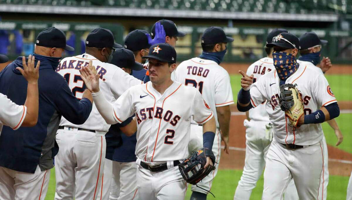 Houston Astros third baseman Alex Bregman (2) celebrates with teammates after the Astros 4-1 win over the Texas Rangers after an MLB baseball game at Minute Maid Park, Tuesday, September 15, 2020, in Houston.