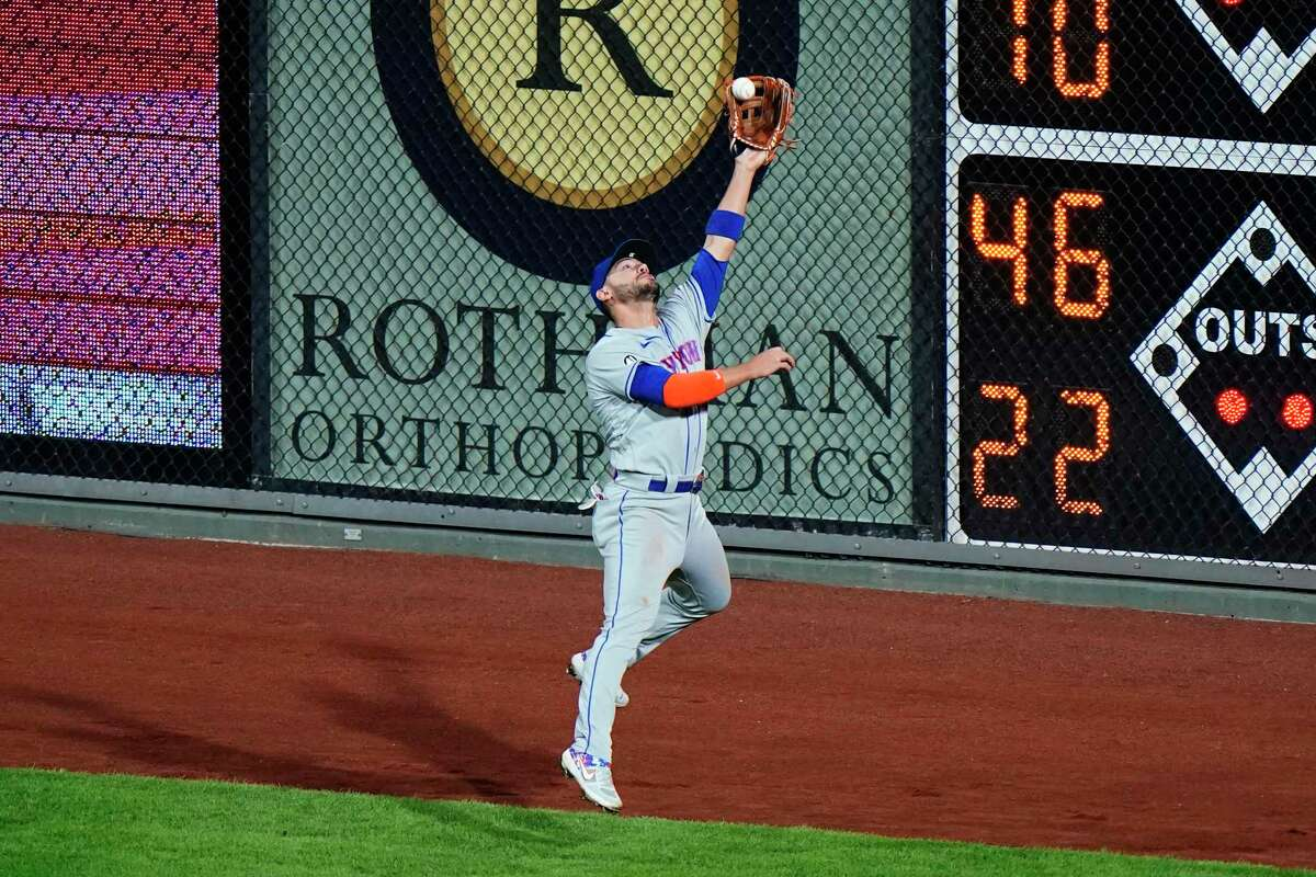 New York Mets right fielder Michael Conforto catches a fly out by Philadelphia Phillies' Roman Quinn during the fourth inning of a baseball game, Tuesday, Sept. 15, 2020, in Philadelphia. (AP Photo/Matt Slocum)