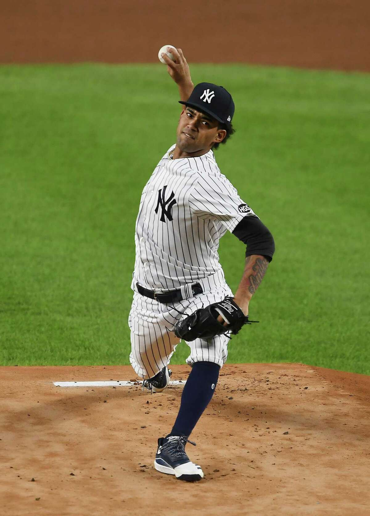 NEW YORK, NEW YORK - SEPTEMBER 15: Deivi Garcia #83 of the New York Yankees pitches during the first inning against the Toronto Blue Jays at Yankee Stadium on September 15, 2020 in the Bronx borough of New York City. (Photo by Sarah Stier/Getty Images)