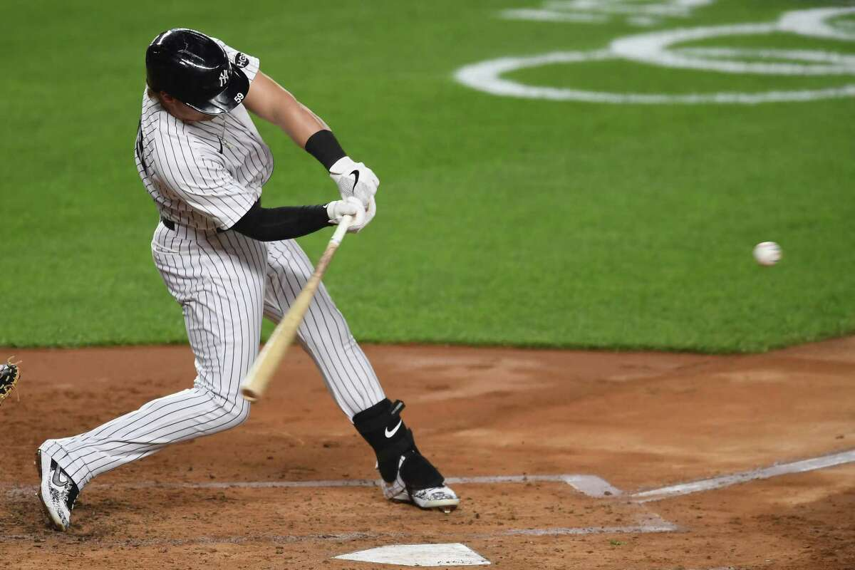 NEW YORK, NEW YORK - SEPTEMBER 15: Luke Voit #59 of the New York Yankees hits a three-run home run during the second inning against the Toronto Blue Jays at Yankee Stadium on September 15, 2020 in the Bronx borough of New York City. (Photo by Sarah Stier/Getty Images)