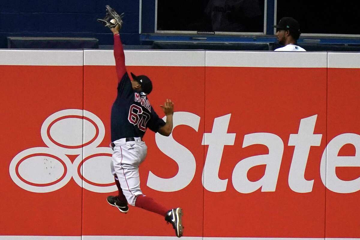 Boston Red Sox left fielder Yairo Munoz catches a ball hit by Miami Marlins' Jazz Chisholm during the eighth inning of a baseball game, Tuesday, Sept. 15, 2020, in Miami. (AP Photo/Lynne Sladky)