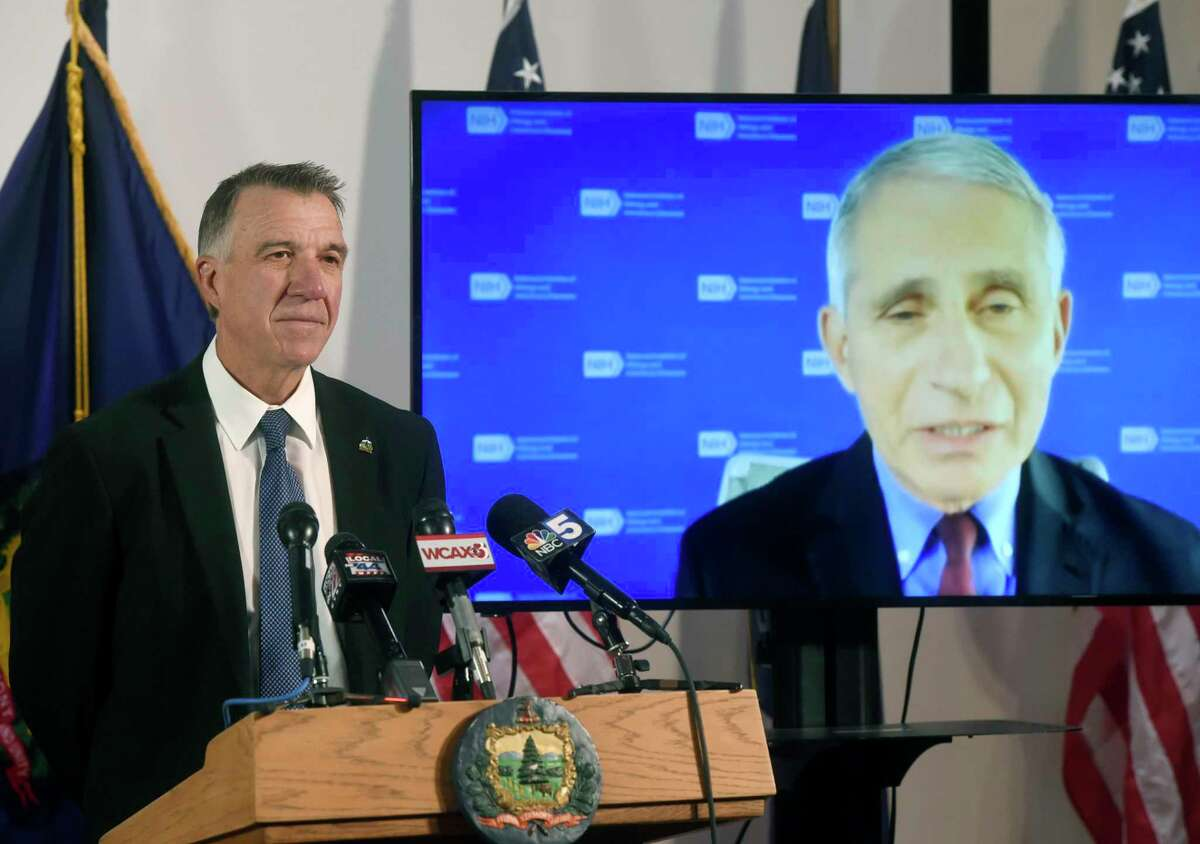 Vermont's Gov. Phil Scott, left, listens as Dr. Anthony Fauci, director of the National Institute of Allergy and Infectious Diseases, discusses Vermont's response to the COVID-19 pandemic during a press conference Tuesday, Sept. 15, 2020, in Montpelier, Vt. (Jeb Wallace-Brodeur/The Times Argus via AP)