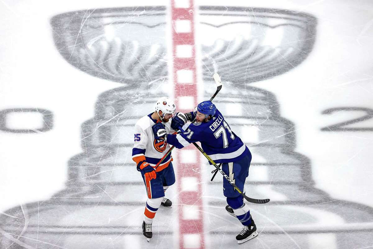 EDMONTON, ALBERTA - SEPTEMBER 15: Anthony Cirelli #71 of the Tampa Bay Lightning checks Devon Toews #25 of the New York Islanders during the third period in Game Five of the Eastern Conference Final during the 2020 NHL Stanley Cup Playoffs at Rogers Place on September 15, 2020 in Edmonton, Alberta, Canada. (Photo by Bruce Bennett/Getty Images)