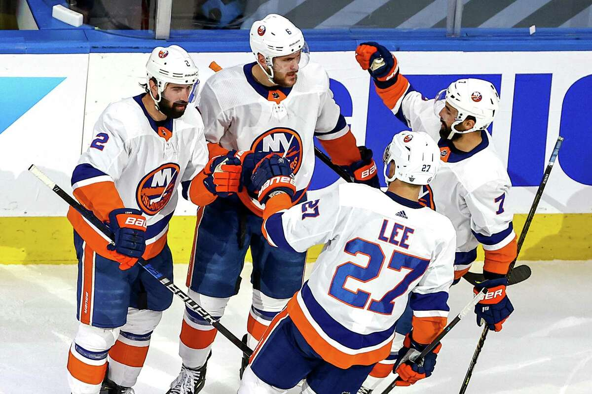 EDMONTON, ALBERTA - SEPTEMBER 15: Ryan Pulock #6 of the New York Islanders is congratulated by his teammates after scoring a goal against the Tampa Bay Lightning during the first period in Game Five of the Eastern Conference Final during the 2020 NHL Stanley Cup Playoffs at Rogers Place on September 15, 2020 in Edmonton, Alberta, Canada. (Photo by Bruce Bennett/Getty Images)