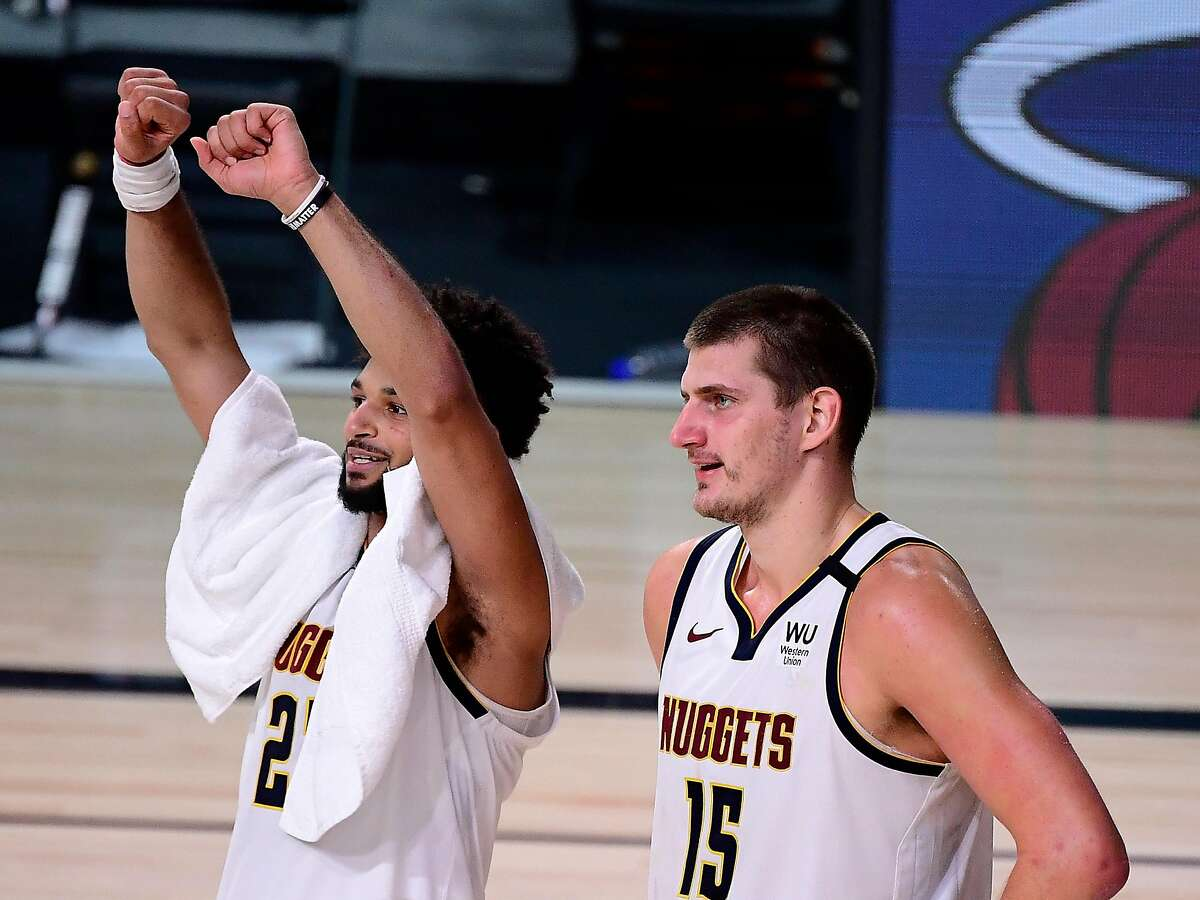 LAKE BUENA VISTA, FLORIDA - SEPTEMBER 15: Nikola Jokic #15 of the Denver Nuggets and Jamal Murray #27 of the Denver Nuggets celebrate their win over LA Clippers in Game Seven of the Western Conference Second Round during the 2020 NBA Playoffs at AdventHealth Arena at the ESPN Wide World Of Sports Complex on September 15, 2020 in Lake Buena Vista, Florida. NOTE TO USER: User expressly acknowledges and agrees that, by downloading and or using this photograph, User is consenting to the terms and conditions of the Getty Images License Agreement. (Photo by Douglas P. DeFelice/Getty Images)