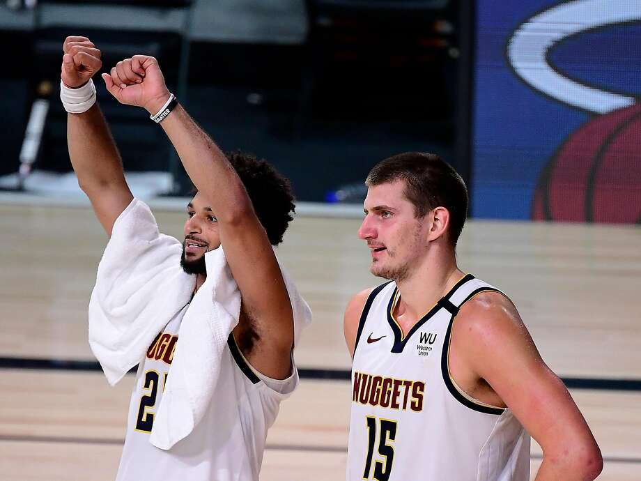 LAKE BUENA VISTA, FLORIDA - SEPTEMBER 15: Nikola Jokic #15 of the Denver Nuggets and Jamal Murray #27 of the Denver Nuggets celebrate their win over LA Clippers in Game Seven of the Western Conference Second Round during the 2020 NBA Playoffs at AdventHealth Arena at the ESPN Wide World Of Sports Complex on September 15, 2020 in Lake Buena Vista, Florida. NOTE TO USER: User expressly acknowledges and agrees that, by downloading and or using this photograph, User is consenting to the terms and conditions of the Getty Images License Agreement. (Photo by Douglas P. DeFelice/Getty Images) Photo: Douglas P. DeFelice / Getty Images