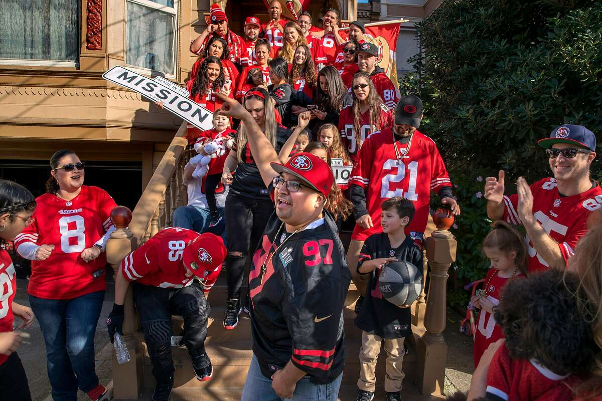 About 40 neighbors gather in January 2020 to recreate a photo they took when the 49ers played in their previous Super Bowl in 2013 in San Francisco. Super Bowl gatherings are strongly discouraged this year.