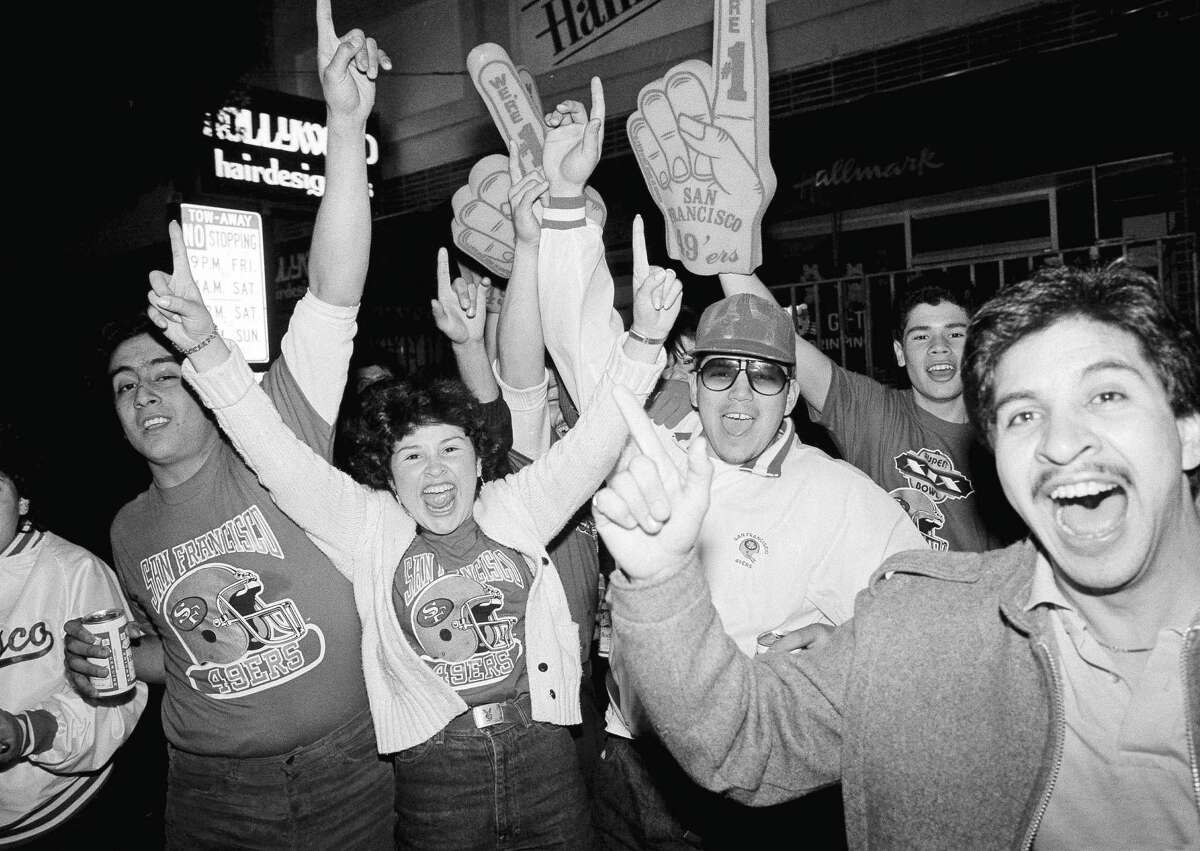 Jubilant 49ers fans celebrate in the Mission District after their team defeated the Miami Dolphins 38-16 in Super Bowl XIX at Stanford Stadium on Jan. 20, 1985.