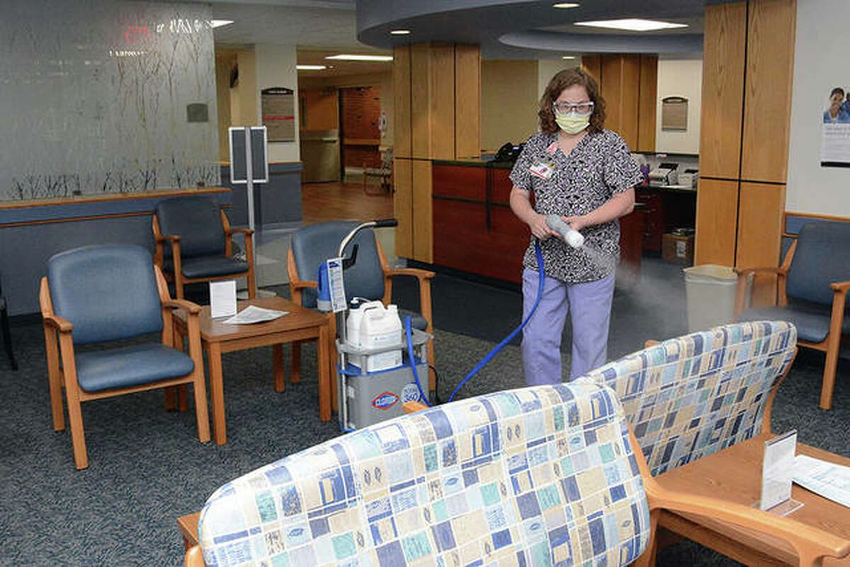 Angela Spray, a member of Passavant Area Hospital's environmental services team, uses a Clorox Total 360 to clean and disinfect the ambulatory surgery waiting room.