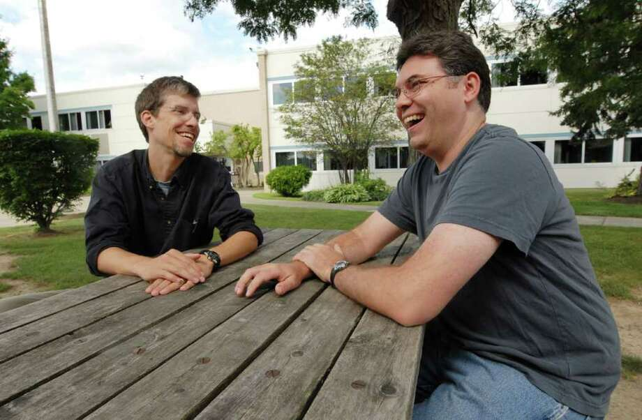 """Matthew McEllington, left, and Larry Tuxbury, right, chat at Shaker Junior High School, where they first became friends. The pair recently penned a children's' book called """"Benjamin Franklinstein Lives!""""  Friday July 30, 2010.  (Will Waldron / Times Union) / 00009691A"""
