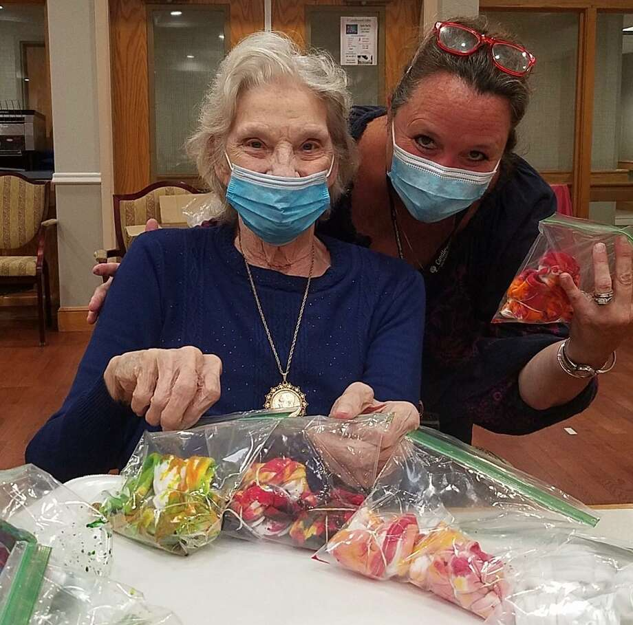 Candlewood Valley Health & Rehab resident Jane Palmer and Recreation Director Kathleen Horvath tie-dye face masks together. Photo: Courtesy Of Candlewood Valley Health & Rehab / Danbury News Times Contributed
