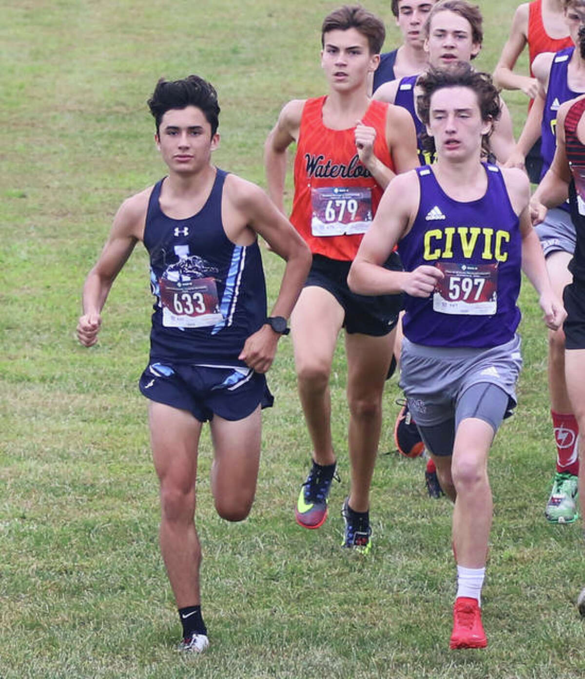 Jersey's Cole Martinez (left) and CM's Aslan Henderson (right) vie for the early lead Saturday at the Pre-MVC Meet at Triad High School in Troy. On Tuesday, Martinez was in Piasa and won a five-team dual at Southwestern High, while Henderson ran second in a triangular at the Bethalto Sports Complex.