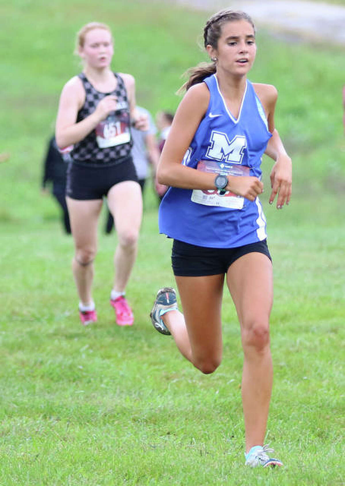 Marquette Catholic's Kailey Vickrey (right), shown in a cross country race last season at SIUE, won the girls race in a five-team meet Tuesday at Southwestern High School in Piasa.