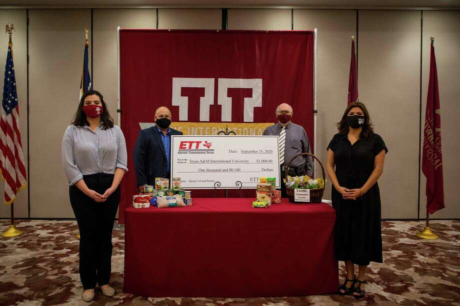 Electric Transmission Texas donated $1,000 Tuesday to Dusty's Food Pantry at TAMIU. Photo: Courtesy Of TAMIU