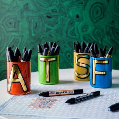 Jonathan Adler's Alphabet brush pots, $55, jonathanadler.com