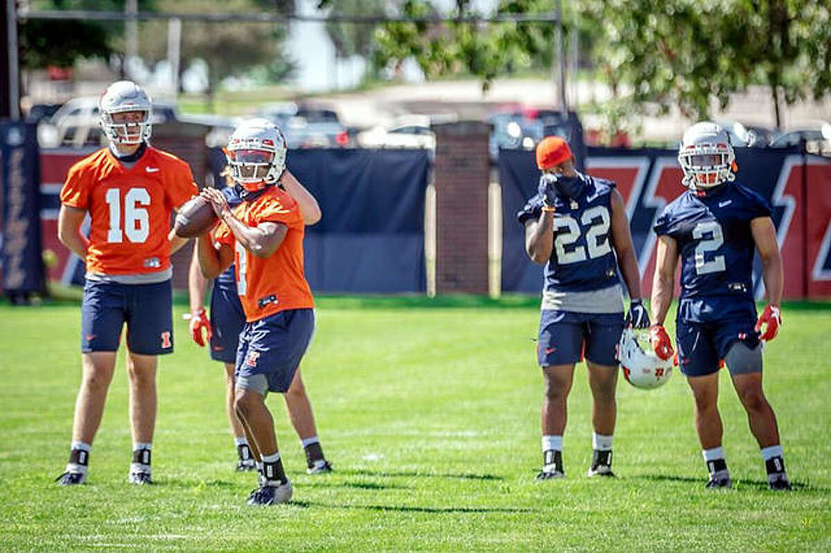 University of Illinois players take part in drills during an Aug. 7 Fighting Illini football practice in Champaign.