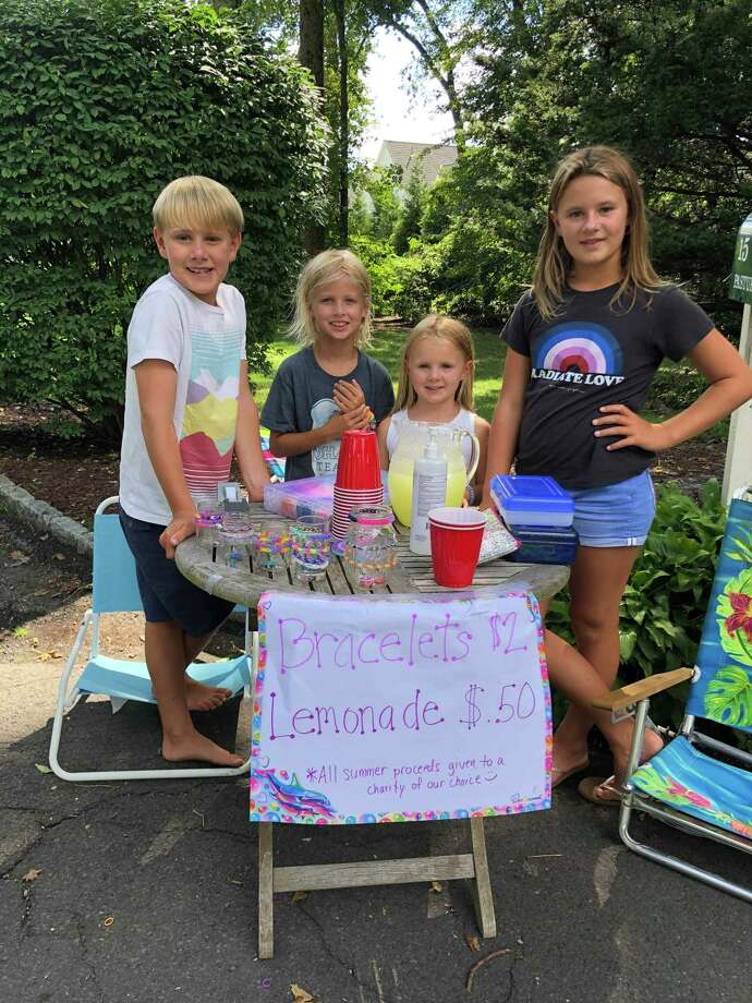 From left, Wesley Gird, 8; Sterling Mountain, 8; Juliet Gird, 5; and Siena Gird, 10. They all sold bracelets and gave the profits to Person-To-Person. Photo: Alison Gird / Contributed Photos / Connecticut Post