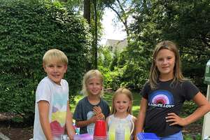 From left, Wesley Gird, 8; Sterling Mountain, 8; Juliet Gird, 5; and Siena Gird, 10. They all sold bracelets and gave the profits to Person-To-Person.