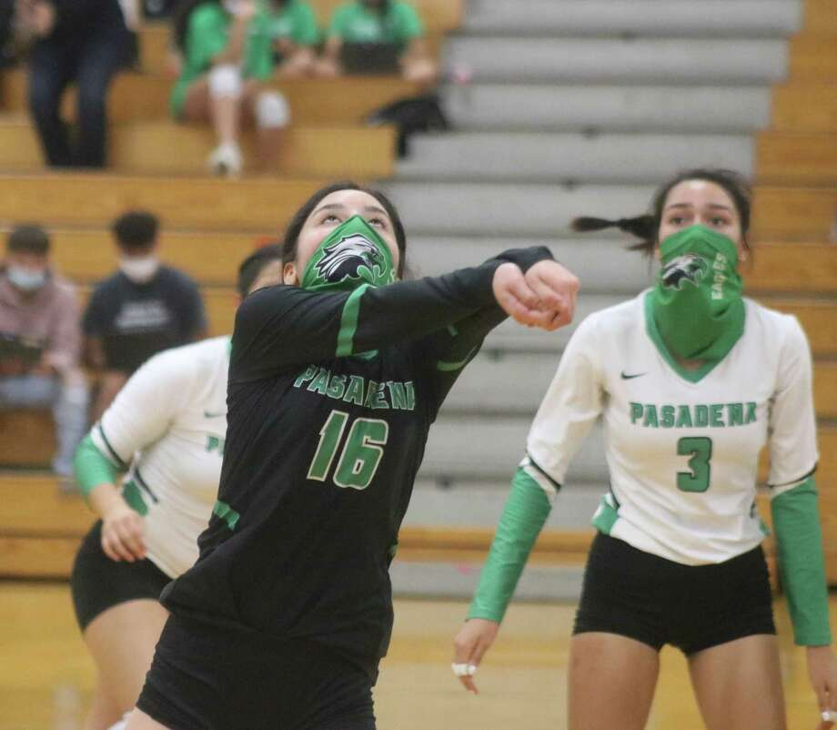 Pasadena libero Britney Telles watches to see where her pass is headed during Game 1 action Tuesday night. Looking on is Alyza Jaramillo. Photo: Robert Avery