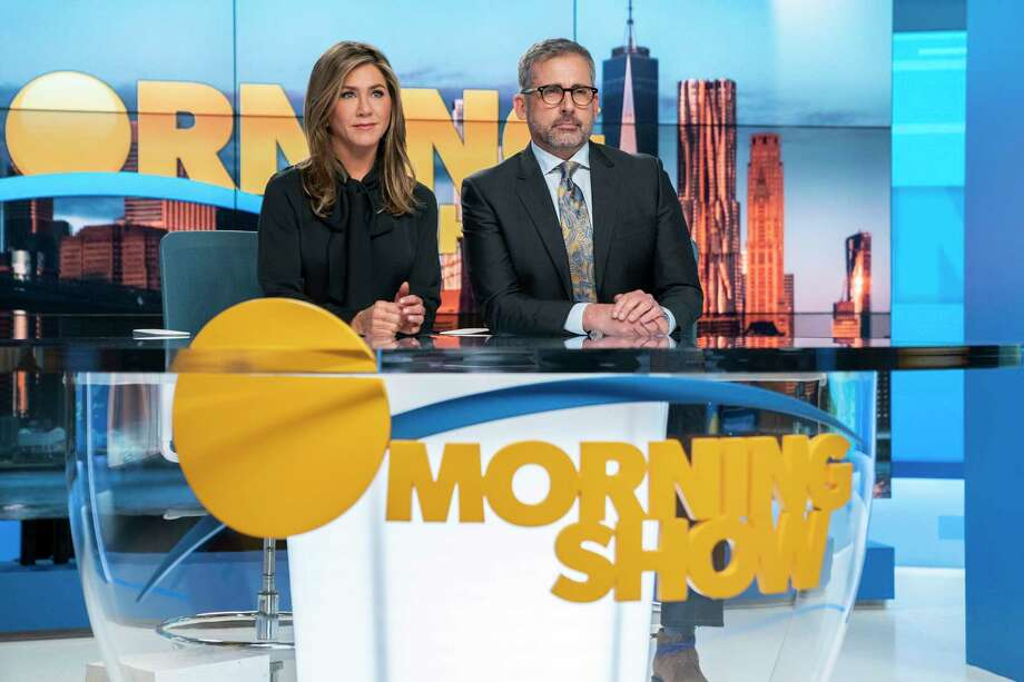 """This image released by Apple TV Plus shows Jennifer Aniston, left, and Steve Carell in a scene from """"The Morning Show."""" On Wednesday, Dec. 11, 2019, Carell was nominated for a SAG Award for best actor in a drama series. Aniston was also nominated for best actress in a drama series. (Hilary B. Gayle/Apple TV Plus via AP) Photo: Hilary B Gayle / Associated Press / Apple TV Plus"""