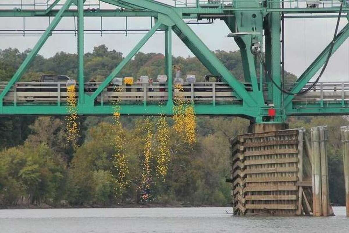 In this photo from last year's race, specators watch as more than 1,000 ducks were dropped from the Joe Paige Bridge in Calhoun County.