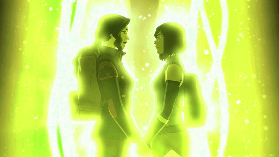 """Asami, left, and Korra hold hands in the series finale of """"The Legend of Korra."""" Photo: Nickelodeon / Nickelodeon"""