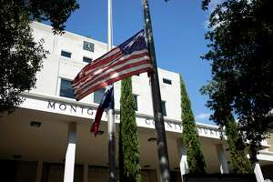 Both the American and Texas flag are flown at half-staff at the Montgomery County Courthouse in Conroe, Tuesday, Sept. 15, 2020. Following actions by the city of Conroe, Gov. Greg Abbott ordered the lowering of both the American and Texas flags to half-staff in honor of Mayor Toby Powell who passed away Saturday following a lengthy battle with cancer.
