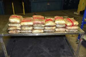 Shown is the 92.99 pounds of meth seized worth more than $1.8 million.