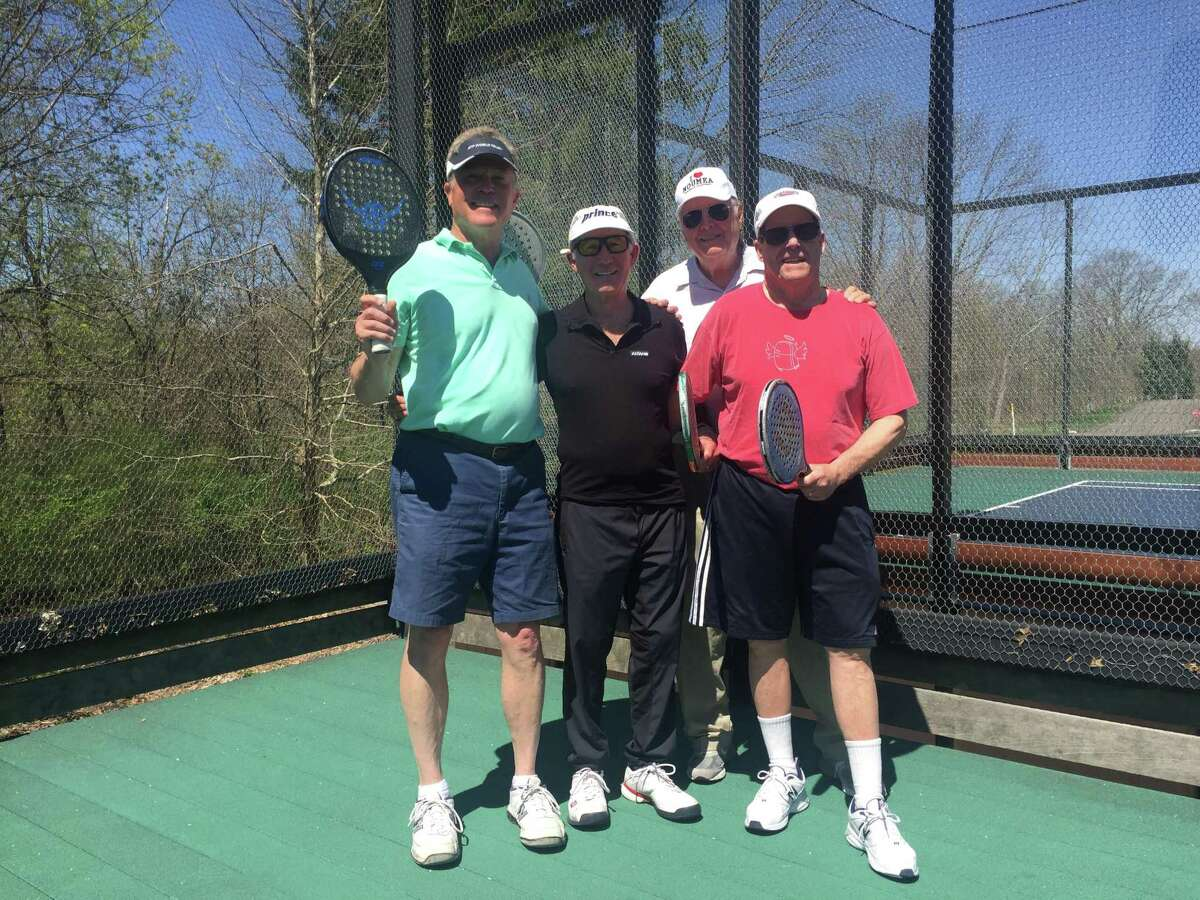 The team of members, Roger DeBard, and Keith Rickey, and the team of members, Jack Foster, and Joel Pelzner pose for a photo at the previous year's New Canaan Men's Club Platform Tennis Tournament, also known as The Waveny Open, at some paddle tennis courts in the town. The members of the town's Board of Selectmen repeated a vote last week, that they made last month on an agenda item with an error.