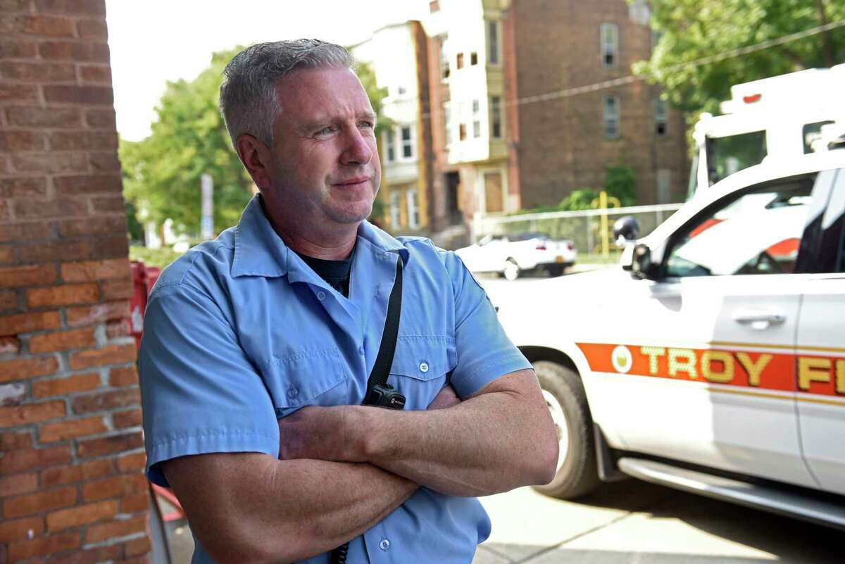 Firefighter Thomas Blake III stands outside the historic Engine 6 Fire House on his last day on the job on Wednesday, Sept. 16, 2020 in Troy, N.Y. At 55, Blake is retiring from the Troy Fire Department. (Lori Van Buren/Times Union)