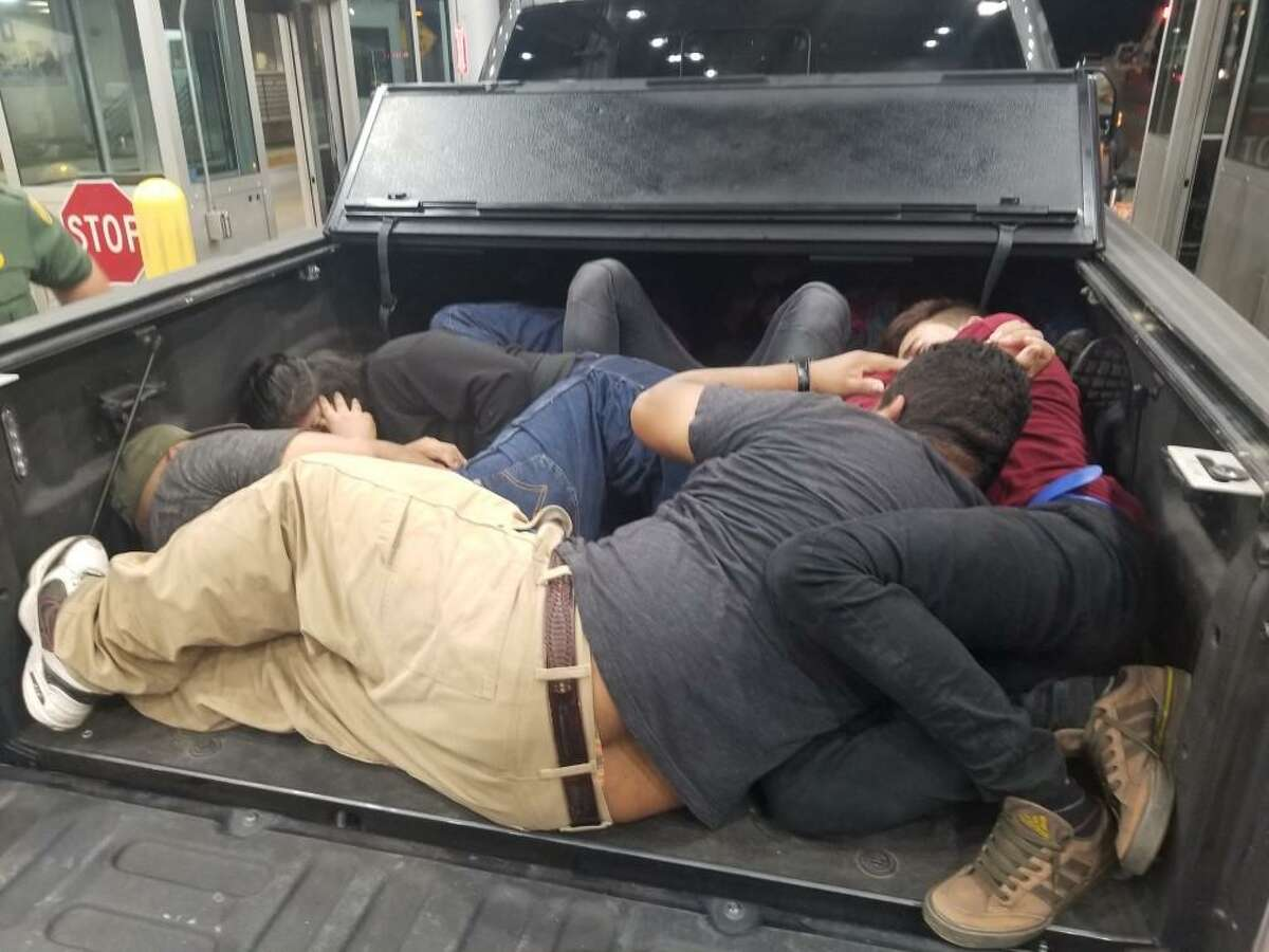 Shown are the immigrants found hiding in the bed of a truck at the I-35 checkpoint.