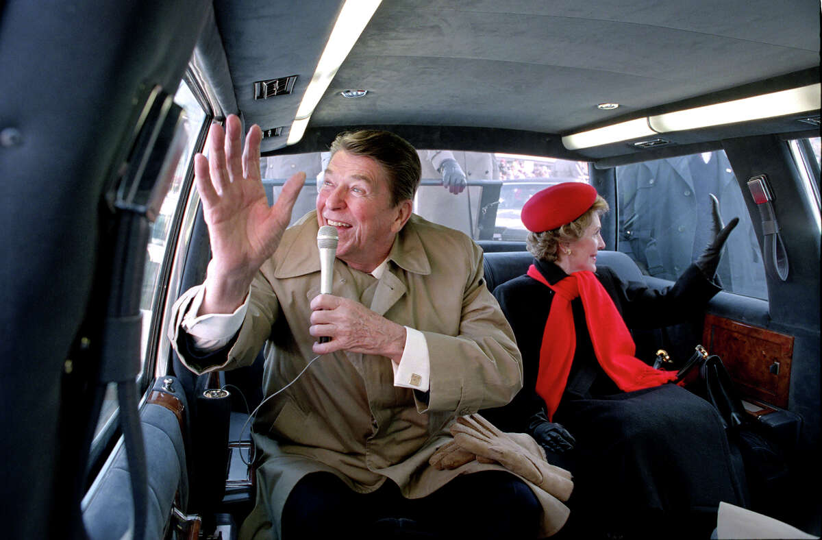 President Ronald Reagan and Nancy Reagan wave to the crowd in Dixon, Ill., in February 1984.